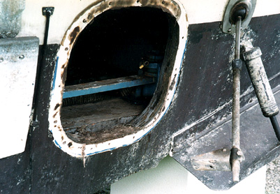 Close-up of Inboard/Outboard transom with engine removed showing rotting wood